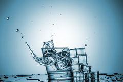 Water in glass with water splash Royalty Free Stock Images
