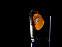 Water in glass with water splash with tangerine energy Royalty Free Stock Photos