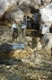 Water Glass. On a wild brook Stock Photo