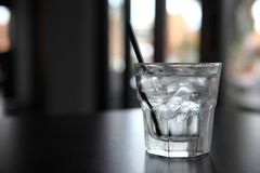 Water in glass on the table. In close up stock photos