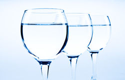 Water glasses. On blue background Stock Photography