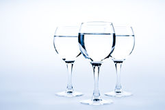 Water glasses. On blue background Stock Images