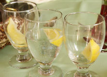 Water Glasses with Lemon. In a restaurant Stock Image