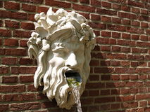 Water God spewing. Water near Palace Het Loo in Holland Stock Photography