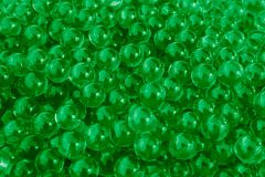 Water green gel balls with bokeh. Polymer gel. Silica gel. Balls of green hydrogel. Crystal liquid ball with reflection. Green. Texture background stock images