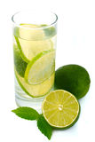Water with green lime . Royalty Free Stock Photos