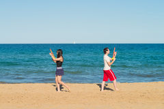Water gun duel on the beach Royalty Free Stock Images