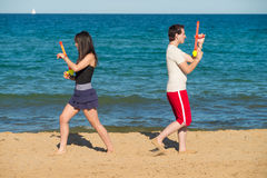 Water gun duel on the sand Royalty Free Stock Images