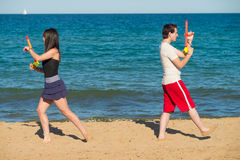 Water gun duel on the shore Royalty Free Stock Image