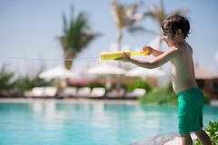 Water gun. Kid playing with water gun royalty free stock photos