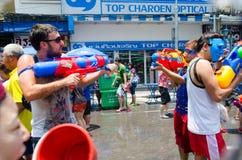 Water gun shootout. Bangkok, Thailand, 14 April 2015. Festival goers at Khao San Road spraying each other with water guns during the annual Songkran water Royalty Free Stock Photos