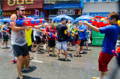 Water gun shootout. Bangkok, Thailand, 14 April 2015. Festival goers at Khao San Road spraying each other with water guns during the annual Songkran water Royalty Free Stock Photo