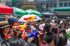 Water gun spray. Bangkok, Thailand, 14 April 2015. Women partygoers shooting water guns at the Songkran street party in Khao San Road. The annual Songkran water Royalty Free Stock Photo