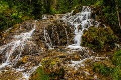 Flowing water, Big Hill Springs Provincial Recreation Area, Alberta, Canada. Water gushes over the natural spring during the late summer months stock image