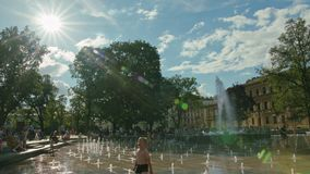 Water Gushes Splashes in Fountain, Lublin, Poland. Lublin, Poland - July 2017: Water gushes and splashes in City Fountain. Kids are running in fountain. Metal royalty free stock photos