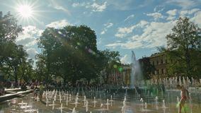Water Gushes Splashes in Fountain, Lublin, Poland. Lublin, Poland - July 2017: Water gushes and splashes in City Fountain. Kids are running in fountain. Metal stock images
