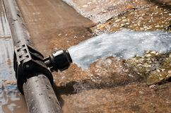 Water gushing out of the pipeline during construction. Site stock photos