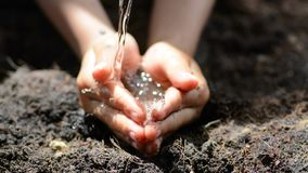 Water in hand stock footage