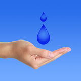 Water with hand. Detail of water with hand on blue background Stock Photo
