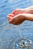 Water in hands Royalty Free Stock Photos
