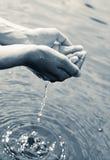 Water in hands Stock Photos