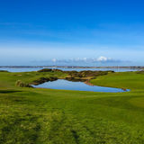 Water Hazard, Galway Bay, Ireland. Wild Atlantic Way, Ireland - Water hazard with Galway Bay in the distance stock photos