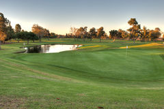 Water hazard and putting green Royalty Free Stock Photo