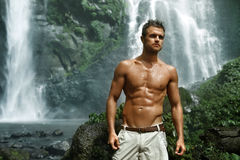 Water. Healthy Man With Sexy Body Near Waterfall. Healthcare Royalty Free Stock Photos