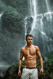 Water. Healthy Man With Sexy Body Near Waterfall. Healthcare Royalty Free Stock Image