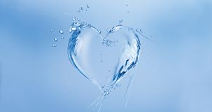 Water Heart. A heart made of water floating in blue water royalty free stock photos