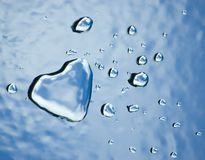 Water heart and drops. Abstract water heart and drops on textured surface. Valentine concept Stock Images