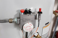 Water heater controls. New gas water heater's temperature controls royalty free stock photo
