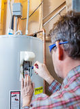 Water heater maintenance Royalty Free Stock Photography