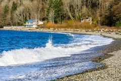 Seahurst Beach Shorebreak 3. Water hits the shoreline at Seahurst Beach in Burien, Washington stock photo