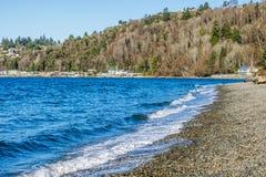 Seahurst Beach Shorebreak. Water hits the shoreline at Seahurst Beach in Burien, Washington stock images