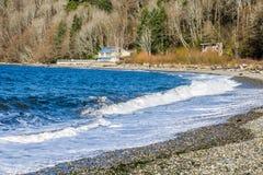 Seahurst Beach Shorebreak 4. Water hits the shoreline at Seahurst Beach in Burien, Washington stock photos