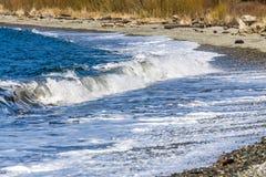 Seahurst Beach Shorebreak 2. Water hits the shoreline at Seahurst Beach in Burien, Washington stock images