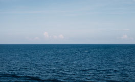 Water horizon with blue skies Stock Image