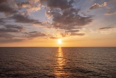 Water horizon with sun setting royalty free stock photos