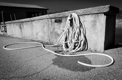 Water hose. Black and white view of water house on farm outbuilding royalty free stock photos