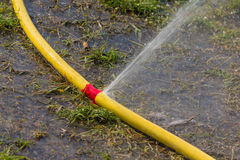 Water hose has sprung. A leak when watering Royalty Free Stock Photography
