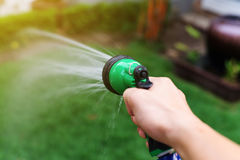 water hose or spray at garden Stock Images