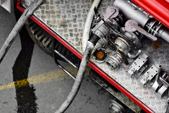 Water hoses on a firefighter vehicle Stock Photo