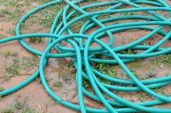 Water hoses on the garden Royalty Free Stock Photography