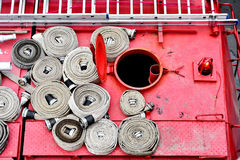 Water hoses on top of a firefighter vehicle Royalty Free Stock Photo