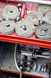 Water hoses on top of a firefighter vehicle Royalty Free Stock Images