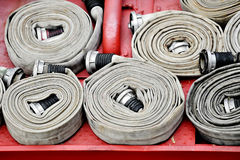 Water hoses on top of a firefighter vehicle Royalty Free Stock Photos