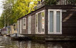 Water House. In Amsterdam canal Royalty Free Stock Photo