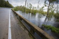 Water from Hurricane Florence about to inundate a bridge. Raeford, North Carolina, United States/August 17, 2018: Flood waters backing up on a bridge just south Stock Image