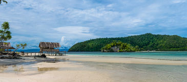 Water Hut of Homestay on Kri Island. Raja Ampat, Indonesia, West Papua. Wide Royalty Free Stock Photo